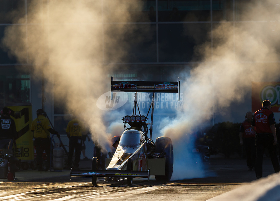 Mar 17, 2017; Gainesville , FL, USA; NHRA top fuel driver Leah Pritchett does a burnout during qualifying for the Gatornationals at Gainesville Raceway. Mandatory Credit: Mark J. Rebilas-USA TODAY Sports