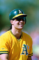 PHOENIX, AZ - Jose Canseco of the Oakland Athletics jokes around during a spring training game against the San Francisco Giants at Phoenix Municipal Stadium in Phoenix, Arizona in 1992. Photo by Brad Mangin
