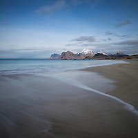 Waves wash over soft sands at Storsandnes beach, Flakstadøy, Lofoten Islands, Norway