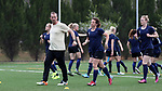 CHARLOTTE, NC - MARCH 25: Courage assistant coach Scott Vallow (left) leads the team through warmups. The NWSL's North Carolina Courage played their first preseason game against the University of Tennessee Volunteers on March 25, 2017, at Queens University of Charlotte Sports Complex in Charlotte, NC. The Courage won the match 3-0.