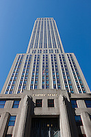 A view of the Empire State Building looking up from 5th Avenue in New York City, New York