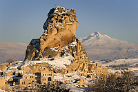Goreme, Cappadocia, Nevsehir, Turkey, winter 2005. The castle of Ortahisar with Mt erciyes volcano in the background. The Valleys of the Goreme National Park offer some very good snow shoeing. Many people who visit in the summer do not realize that temperatures in winter can go as low as minus 25 celcius, with a meter of snow on the ground.Photo by Frits Meyst / MeystPhoto.com
