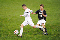 Nick Weightman (7) of the Cincinnati Bearcats is marked by Daniel Fabian (19) of the Providence Friars. The Providence Friars defeated the Cincinnati Bearcats 2-1 during the semi-finals of the Big East Men's Soccer Championship at Red Bull Arena in Harrison, NJ, on November 12, 2010.