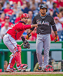 22 September 2013: Washington Nationals catcher Jhonatan Solano asks for a call from the first base umpire as he tags his brother Donovan Solano out during game action against the Miami Marlins at Nationals Park in Washington, DC. The Marlins defeated the Nationals 4-2 in the first game of their day/night double-header. Mandatory Credit: Ed Wolfstein Photo *** RAW (NEF) Image File Available ***