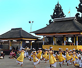 Boys in yellow and white dancing at the Puri Agung ceremony, Bali, Indonesia.