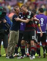 USA coach Juergen Klinsmann hugs Per Mertesacker of Germany at full time