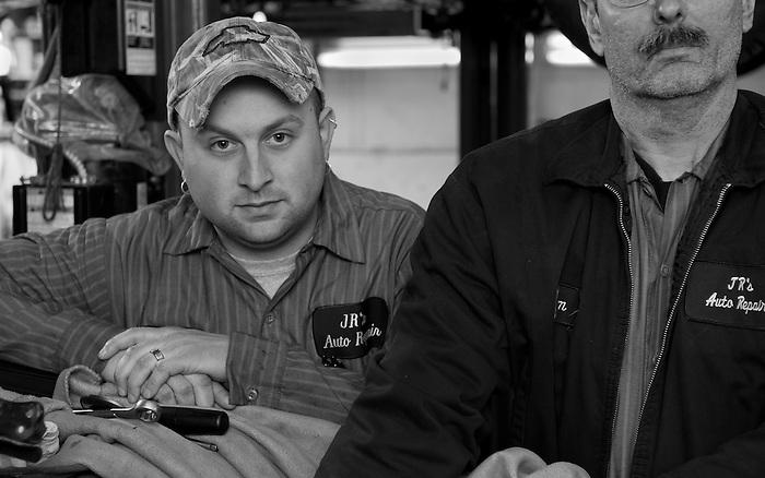 Two Mechanics in an Auto Repair Garage