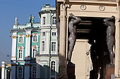 the atlantes of the Hermitage Museum at historical centre of St. Petersberg . prominent use of atlantes is at the entrance of the Hermitage Museum built for Tsar Nicholas I of Russia. The portico of this building has ten enormous atlantes (approximately three times life-size) carved from Serdobol granite designed by Leo von Klenze and executed by the sculptor Alexander Terebenev working with one hundred and fifty assistants,  atlas (also known as a atlant, or atlantid; plural atlantes) is a support sculpted in the form of a man, which may take the place of a column, a pier or a pilaster. The Roman term for such a sculptural support is telamon (plural telamones or telamons)..///.les atlantes du musee de l'hermitage a Saint petersbourg