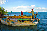 Men and boat in Cayos Ana Maria, Ciego de Avila, Cuba.
