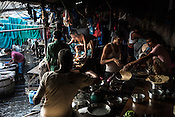 Washermen(locally known as Dhobis) gather to cook breakfast in Dhobighat, the world's largest laundomat in India's financial capital, Mumbai, India.