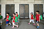 Korean children walk past memorial role call with the names of soldiers who died during the Korean War at the National War Museum in  Seoul, South Korea on 23 June, 2010..Photographer: Rob Gilhooly .