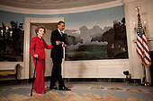 Washington, DC - June 2, 2009 -- United States President Barack Obama escorts former First Lady Nancy Reagan in the Diplomatic Room of the White House June 2, 2009, for the announcement and signing of the Ronald Reagan Centennial Commission Act--commemorating the late President's 100th Birthday in 2011. &nbsp;<br /> Mandatory Credit: Pete Souza - White House via CNP