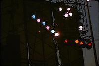 Lights at right upper Wall of Sound rigging. Grateful Dead Live at Dillon Stadium, Hartford, CT 31 July 1974. Shot at Dusk, some sunlight still in sky behind wind scrim.