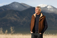 handsome gray haired man outdoors in a winter coat