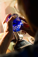 Edokiriko artisan Ryuzo Mita working on a glass in the early stages of cutting. Shimizu Glass, Tokyo, Japan, January 14, 2015. Edokiriko is a style of cut glass that dates back to 1834 and is similar to British cut glass. It makes use coloured glass and highly-intricate Japanese motifs.
