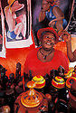 Woman with local art and crafts in her street vendor stall on Boat Day, Otrobanda waterfront, Willemstad, Curacao, Netherlands Antilles.