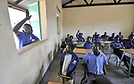 Philip Nyumba speaks to students in a school in the Southern Sudanese village of Kenyi. The school was constructed by the United Methodist Committee on Relief (UMCOR).  Families here are rebuilding their lives after returning from refuge in Uganda in 2006 following the 2005 Comprehensive Peace Agreement between the north and south. Nyumba is the deputy program manager for UMCOR in the region. NOTE: In July 2011, Southern Sudan became the independent country of South Sudan