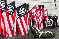 UNGARN, 13.02.2016, Budapest - I. Bezirk.  Gedenken des Ausbruchsversuchs deutscher und ungarischer Stadtverteidiger unter sowjetischer Belagerung am 11. Februar 1945 auf dem Kapisztr&aacute;n-Platz vor dem Kriegsmuseum. Der blutig missglueckte Ausbruch gilt bei den Nazis als &quot;Tag der Ehre&quot;. -Kraenze mit Flaggen der &quot;Hungaristischen Bewegung&quot; und der &quot;Ungarischen Nationalen Front&quot; MNA. Im Hintergrund Kerle mit der magischen Zahl &quot;88&quot;, die fuer &quot;Heil Hitler&quot; steht. | Commemoration of the breakout attempt by German and Hungarian city defenders under Soviet siege, 1945 February 11 on the Kapisztran square in front of the war museum. Nazis regard the fatally failed breakout as &quot;Day of Honor&quot;. -Wreaths with flags of the  &quot;Hungarist Movement&quot; and the &quot;Hungarian National Front&quot; MNA. In the background guys with the magic number &quot;88&quot; which stands for &quot;Heil Hitler&quot;.<br /> &copy; Martin Fejer/EST&amp;OST