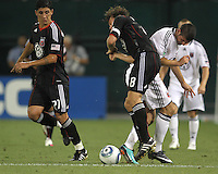 Carey Talley #8 of D.C. United crashes into Ellis Martin #19 of Portsmouth FC during an international friendly match at RFK Stadium on July 24 2010, in Washington D.C. United won 4-0.