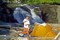 Nootka Island, British Columbia, Canada, August 2006. The waterfalls of Calvin Creek are the highlight of the Nootka Trail. One can camp on the beach directly in front of the falls while taking a refreshing plunge inside. Trekking the Nootka trail takes hikers through dense rainforest and along beaches full of marine life. Photo by Frits Meyst/Adventure4ever.com.