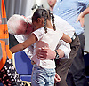 Jeremy Corbyn <br /> Rally in Kilburn, London, Great Britain <br /> 21st August 2016 <br /> <br /> billed as his largest indoor rally during the current Labour Leadership campaign to date. <br /> embraces a little girl who runs onto the stage when he finished <br /> <br /> Jeremy Corbyn MP<br /> Islington North and leader of the Labour party <br /> <br /> Photograph by Elliott Franks <br /> Image licensed to Elliott Franks Photography Services