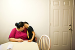 Sophia Sawyer comforts her son Daniel, January 27, 2010 at their home in Sacramento, Calif. The Sawyer family receives $540/month in CalWORKs assistance from the state of California. Dennis is currently unable to work while recovering from cancer, and Sophia hasn't been able to find work. Gov. Arnold Schwarzenegger has proposed eliminating the CalWORKs program in an effort to balance the state's budget. CREDIT: Max Whittaker for The Wall Street Journal.CABUDGET