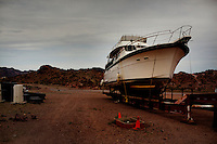 CREDIT: Daryl Peveto / LUCEO for The Wall Street Journal.Photo Assignment ID: 11416 Slug: LAKEMEAD ..Lake Mead, Nevada, March 16, 2011 - Trailered boats sit at Las Vegas Bay on Lake Mead. Lake Mead has been one of America's most popular recreation areas, with a 12-month season that attracts more than 9 million visitors each year for swimming, boating, skiing, fishing and other outdoor pursuits. Currently it is experiencing a 10 year drought that has diminished the water to levels not seen since the lake was created. ..Lake Mead is the largest water reservoir in the United States. Located on the Colorado River southeast of Las Vegas, it is the major reserve for Nevada, California and Arizona. The city of Las Vegas alone gets 90% of its water from Lake Mead. The lake is currently experiencing a ten year drought, recently dropping to1,083 feet - its lowest level since it was dammed in the 1930s. If it drops further, there is the potential for cutoffs of water for hydro-electricity, agriculture and cities across the Southwest. The current level is near emergency level: if drops to 1075, the Secretary of Interior will have to declare a severe water emergency and major cutbacks will ensue. If gets below 1025, all water for hydro from Hoover Dam shut off. If it falls below 1,000 feet the intake valves that pull water from the Lake for consumption will no longer be operational.