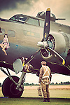 Pilots climbing onboard a B-17G Flying Fortress bomber.
