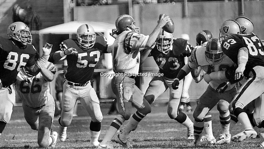 Oakland Raiders afer San Diego quarterback Dan Fouts, rushed by Cedrick Hardman, Rod Martin, Dave Browning and Ted Hendricks..1980 (photo /Ron Riesterer)