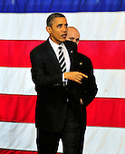United States President Barack Obama gestures towards firefighters following his remarks on the economy at Fire Station #5 in Arlington, Virginia on Friday, February 3, 2012.  .Credit: Ron Sachs / Pool via CNP