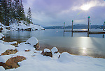 Idaho, North, Kootenai County, Coeur d'Alene. Snow covered rocks on the shore of Lake Coeur d'Alene at Tubbs Hill Nature Park.