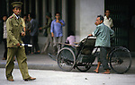 A policeman directs, bicycle and motor traffic in Hanoi, North Vietnam.  (Jim Bryant Photo).....