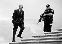 WASHINGTON, DC - A U.S. Capitol Police officer keeps watch on the House steps as Rep. Peter Welch, D-Vt., arrives at the Capitol to vote on the debt ceiling bill in the House of Representatives on Aug. 1, 2011.