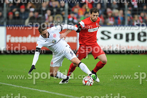 31.01.2015, Schwarzwald Stadion, Freiburg, GER, 1. FBL, SC Freiburg vs Eintracht Frankfurt, 18. Runde, im Bild (l.) Bastian Oczipka (Eintracht Frankfurt) im Zweikampf, Aktion, mit (r.) Admir Mehmedi (SC Freiburg) // during the German Bundesliga 18th round match between SC Freiburg and Eintracht Frankfurt at the Schwarzwald Stadion in Freiburg, Germany on 2015/01/31. EXPA Pictures &copy; 2015, PhotoCredit: EXPA/ Eibner-Pressefoto/ Laegler<br /> <br /> *****ATTENTION - OUT of GER*****