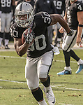 Oakland Raiders running back Jalen Richard (30) makes long run on Sunday, December 04, 2016, at O.co Coliseum in Oakland, California.  The Raiders defeated the Bills 38-24.