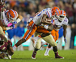 Florida wide receiver Chris Thompson gets tripped up after a reception in the second half of an NCAA college football game against Florida State in Tallahassee, Fla., Saturday, Nov. 26, 2016. Florida State defeated Florida 31-13. (AP Photo/Mark Wallheiser)