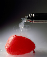 CHARLES' LAW: INFLATED BALLOON AT ROOM TEMPERATURE (2 of 2)<br /> Gas Volume Is Proportional To Temperature<br /> As liquid nitrogen (-196'C or 77'K) is poured over a balloon containing gas at a constant pressure, the gas trapped in the balloon is cooled and the volume decreases in direct proportion to the decrease in temperature .