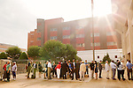 July 13, 2015. Winston Salem, North Carolina.<br />  Citizens and members of the the press line up outside the federal courthouse on the first day of the Nc NAACP v. McCrory trial.<br />  The NC NAACP contests that HB 589 (Voter ID requirements) violate Section 2 of the Voting Rights Act (42 U.S.C. 1973) and the Fourteenth and Fifteenth Amendments of the Constitution.