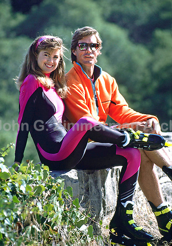 Model Kathy Ireland and husband Greg Olsen roller blading in Santa Barbara, California, July, 1989. Photo by John G. Zimmerman.