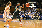 24 February 2012: Miami's Sylvia Bullock (34) passes the ball away from Duke's Tricia Liston (left). The Duke University Blue Devils defeated the University of Miami Hurricanes 74-64 at Cameron Indoor Stadium in Durham, North Carolina in an NCAA Division I Women's basketball game.
