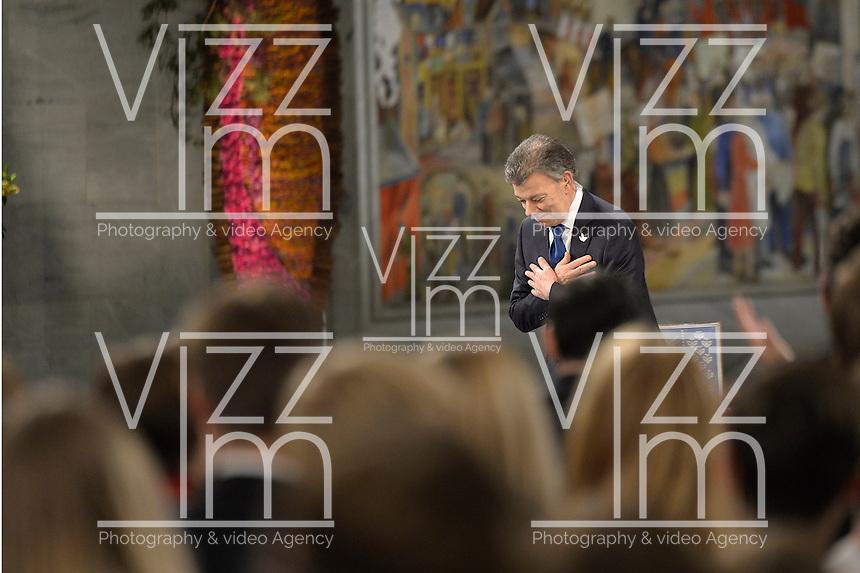 OSLO -NORUEGA-10-12-2016  Juan Manuel Santos, presidente de Colombia, durante la ceremonia de entrega del Premio Nobel de Paz 2016 que obtuvo por su trabajo en pro de la paz en Colombia. El premio fue entregado hoy 10 de diciembre de 2016 en el  Town Hall de Oslo Noruega./ Juan Manuel Santos, president of Colombia, during the ceremony of Nobel Peace Prize 2016. The prize was give to the santos president today December 10 2016 at Oslo Town Hall , Oslo, Norway. / Photo: VizzorImage / Cesar Carrion / SIG.  / HANDOUT PICTURE; MANDATORY EDITORIAL USE ONLY/ NO MARKETING, NO SALES