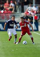 07 August 2010: Chivas USA defender Jonathan Bornstein #13 and Toronto FC defender Dan Gargan #8 in action during a game between Chivas USA and Toronto FC at BMO Field in Toronto..Toronto FC won 2-1.