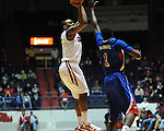 Ole Miss' Dundrecous Nelson (5) shoots over SMU's Ryan Manuel (1) at the C.M. &quot;Tad&quot; Smith Coliseum in Oxford, Miss. on Tuesday, January 3, 2012. Ole Miss won 50-48.