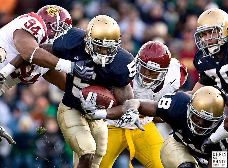 10/17/09 - South Bend, IN:  Notre Dame running back Armando Allen Jr fights for yards during their game against USC at Notre Dame Stadium on Saturday.  USC won the game 34-27 to extend its win streak over Notre Dame to 8 games.  Photo by Christopher McGuire.
