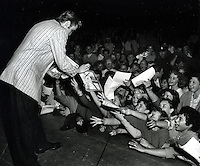 Elvis Presley signing autographs in Oakland, California.(1956 photo)