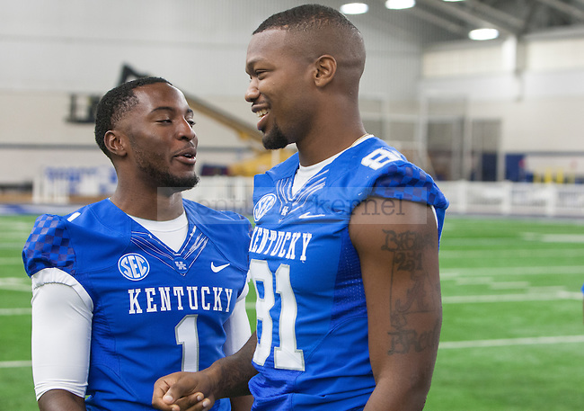 Safety A.J. Stamps and wide receiver Rashad Cunningham laugh together during UK football media day at Nutter Field House in Lexington, Ky., on Friday, August 8, 2014. Photo by Adam Pennavaria | Staff