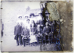 severely eroding glass plate of large group adults and one child