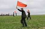 Game bird shoot St Claire's Estate, Hampshire. England. Beaters with their red warning flags.