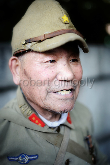 Yoshiaki Kamagata, an Imperial military officer  during World War II, is dressed in World War II garb prior to marching to offer prayer at Yasukuni Shrine in Tokyo on Saturday 15 Aug. 2009. Aug. 15 marks the 64th anniversary of Japan's surrender in the Pacific War and the shrine is seen by nationalists and reformists alike to be the soul of Japan, not least because of the 14 Class A war criminals who are interred there. Wartime prime minister Hideki Tojo is among those enshrined inside the controversial shrine.