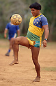 Acculturated brazilian indian, Yaulapiti indigenous people play soccer and wears Brazil soccer team shirt and watch, Xingu, Amazon rainforest, Brazil. Multi-culturalism, mix of traditional culture ( hairstyle ) and influence of the white culture.